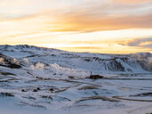 Iceland, snowy landscape with Krafla thermal power plant in winter by sunrise - TAMF01270
