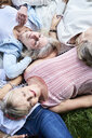 Top view of group of senior women lying in a meadow - IGGF01018