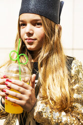 Portrait of girl with plastic cup of orange juice - ERRF00903