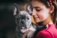 Girl hugging pet dog - ISF21087