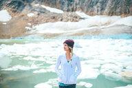 Woman enjoying view by lake, Jasper, Canada - ISF21102