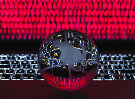 Globe illustrating the Americas on a laptop computer with screen been infected by a cyber attack - ABRF00359