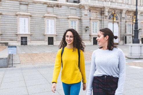 Girlfriends exploring city, Madrid, Spain - CUF50304