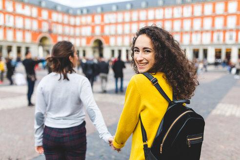 Girlfriends exploring city, Madrid, Spain - CUF50316