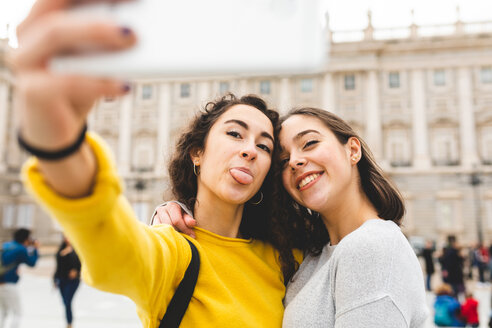 Girlfriends taking selfie in city, Madrid, Spain - CUF50319