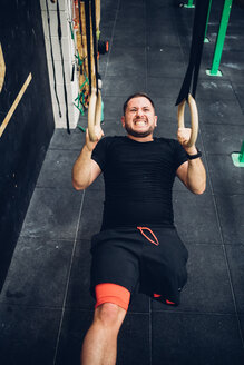 Man with disability training in gym - CUF50355