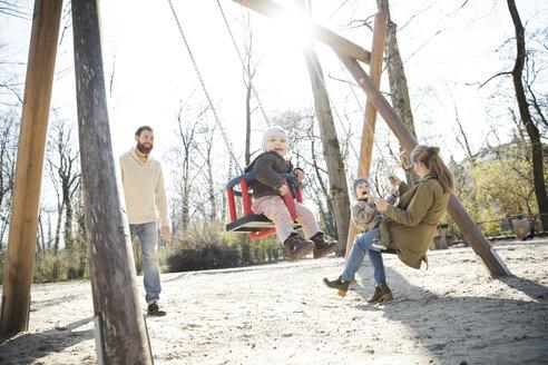 Happy family on playground - MAEF12839