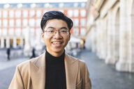 Spain, Madrid, portrait of happy young man at Plaza Mayor - WPEF01481