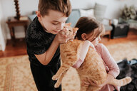 Children playing with cat at home - ISF21195