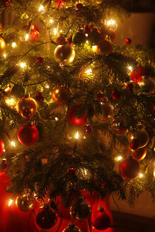 Christmas tree with Christmas baubles and light chains, partial view - JTF01214