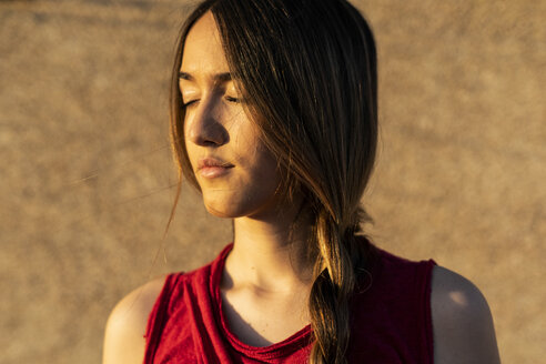 Portrait of teenage girl with closed eyes in sunlight - ERRF00944