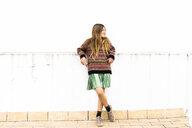 Relaxed girl standing on roof terrace - ERRF00977