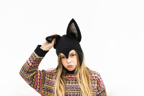 Portrait of displeased girl in bat costume in front of white wall - ERRF00983