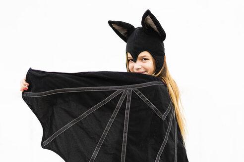 Portrait of girl in bat costume spreading wings - ERRF00989