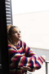 Girl in striped pullover on balcony looking up - ERRF01007