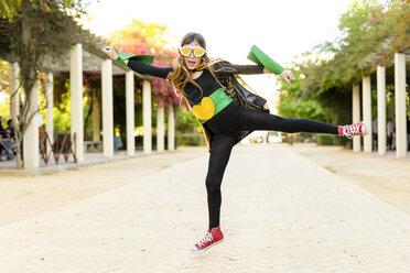 Girl in super heroine costume jumping - ERRF01022