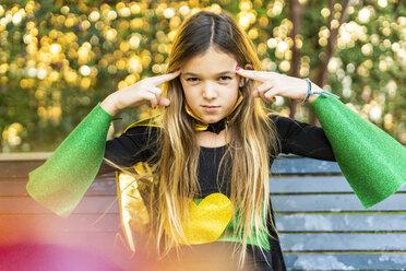 Girl posing in super heroine costume on a bench - ERRF01025