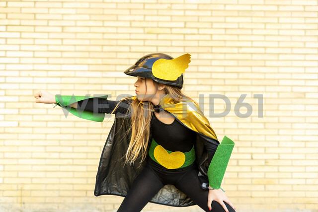 Girl in super heroine costume posing at brick wall - ERRF01028 - Eloisa Ramos/Westend61
