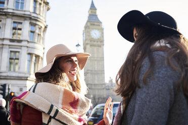 UK, London, two happy women in the city near Big Ben - IGGF01111