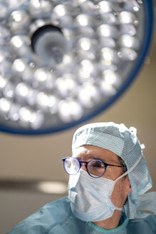 Portrait of doctor surgeon during operation - OCMF00389