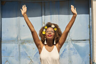 Portrait of happy young woman with red lips wearing glasses and flowers in her hair - VEGF00006
