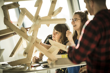 Group of creative professionals building wood object for a project - MJRF00195