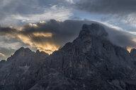 Italy, Dolomites, Passo Rolle, Trentino, Pale di San Martino Mountain group with mountain peak Cimon della Pala at sunrise - RUEF02164
