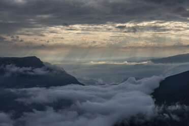 Italy, Dolomites, Sout Tyrol, View from the mountain Seceda to clouds over mountains - RUEF02170
