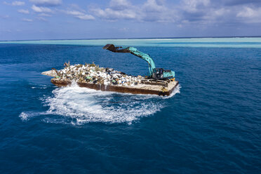 Maledives, South-Male-Atoll, plastic waste disposal with digger - AMF06893