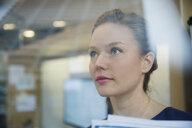 Close up pensive young businesswoman looking away - HEROF35820