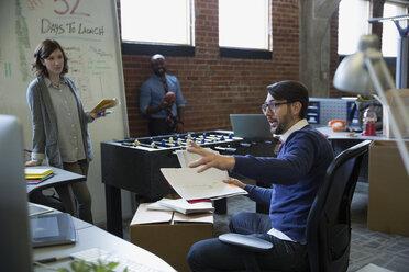Entrepreneurs brainstorming in new office - HEROF35859