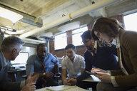 Entrepreneurs brainstorming in office - HEROF35865