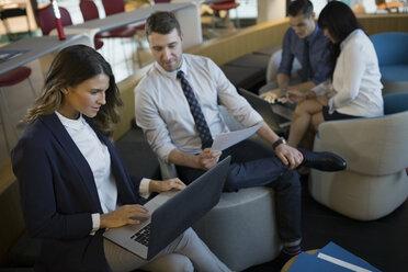 Business people meeting in office lobby - HEROF35910