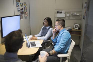 Business people watching monitor in meeting - HEROF35922