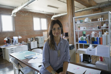 Portrait confident female designer in office - HEROF36126