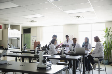 Professor and college students in science laboratory - HEROF36153