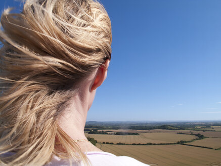 Woman viewing rolling landscape, White Sheet Down, Wiltshire, United Kingdom - JUIF00858