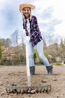 Young woman raking - HMEF00303