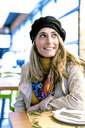 Portrait of smiling woman in a cafe - ERRF01062