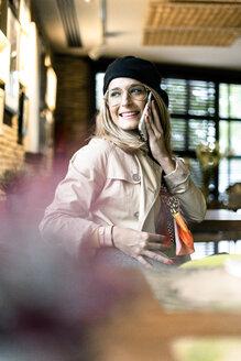 Sevilla, Spain, woman, coffee shop, fall - ERRF01065