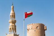 Sultanate Of Oman, Ras al Hadd, Ras al Hadd Castle with Omani flag and minaret - WVF01119