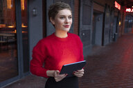 Portrait of confident businesswoman  with digital tablet outdoors - TAMF01279