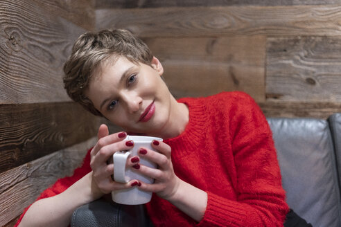 Caucasian white female relaxing in a cafe in Berlin - TAMF01288