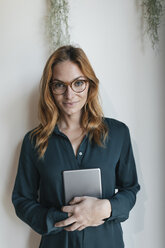 Portrait of confident businesswoman holding tablet - GUSF01920