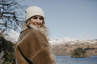 UK, Scotland, portrait of smiling young woman at  Loch Lomond - LHPF00536
