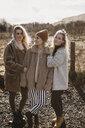 UK, Scotland, female friends standing in rural landscape - LHPF00551