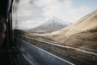 UK, Scotland, Loch Lomond and The Trossachs National Park, road and mountain seen through car window - LHPF00557
