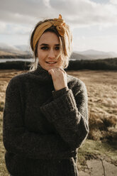 UK, Scotland, Loch Lomond and the Trossachs National Park, portrait of young woman in rural landscape - LHPF00572