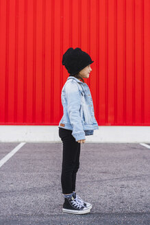 Fashionable little girl wearing denim jacket, black cap and sneakers - ERRF01177