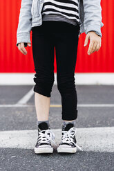 Girl with one trouser leg rolled up, partial view - ERRF01183